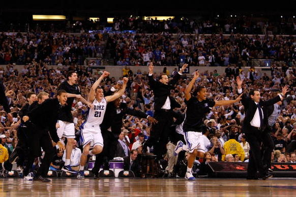 Head coach Mike Krzyzewski (R) of the Duke Blue Devils and his players celebrate after they won 61-59 against the Butler Bulldogs during the 2010 NCAA Division I Men's Basketball National Championship game at Lucas Oil Stadium on April 5, 2010 in Indianapolis, Indiana. (Photo by Jonathan Daniel/Getty Images)