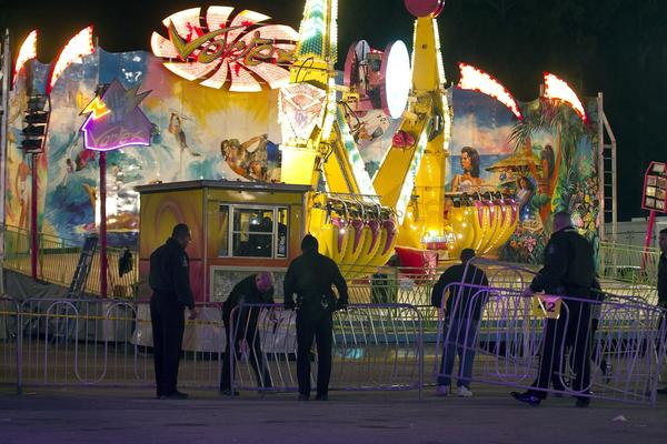 Police secure a barricade around the Vortex after an accident closed the ride at the North Carolina State Fair in Raleigh, N.C.