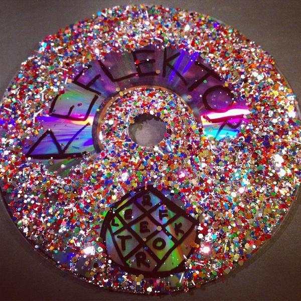 "In response to the social-media challenge ""Our song skips on little silver discs, Make Reflektor art out of your old CDs,"" one fan won tickets with this entry."