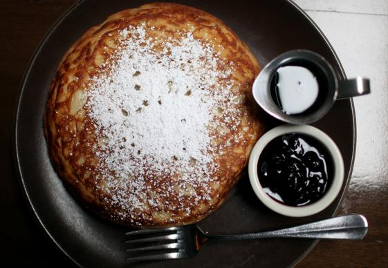 Cooks County's 10-inch, iron skillet cooked pancake comes with  blueberry compote and maple syrup.