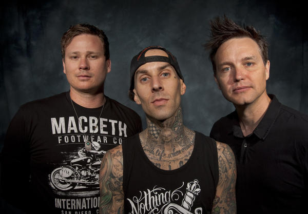 Blink-182 -- from left, guitarist-vocalist Tom DeLonge, drummer Travis Barker and bassist-vocalist Mark Hoppus backstage before a 2011 concert at the Honda Center in Anaheim.