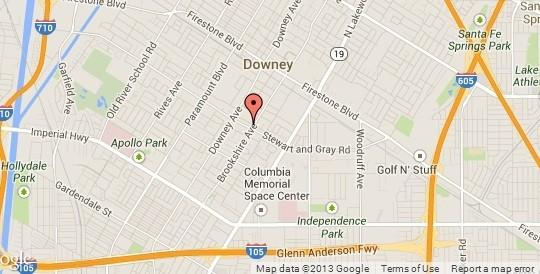 A 15-year-old boy called Downey police and confessed to killing his father Friday morning, according to police.