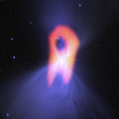 Ghost busted: The frigid Boomerang Nebula reveals its true shape. The image is based on visible light observation, in blue, from the Hubble Space Telescope and short-wavelength radiation detected by the Atacama Large Millimeter/sub-millimeter Array in Chile.