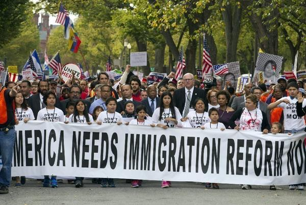 Demonstrators march toward Capitol Hill during a immigration rally in Washington on Oct. 8 seeking to push Republicans to hold a vote on a stalled immigration reform bill.