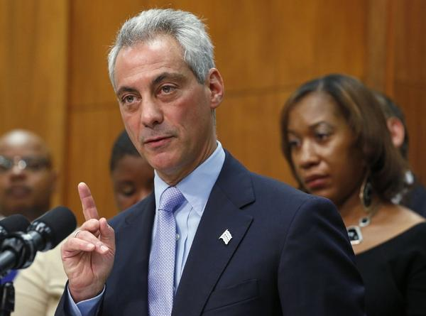 Chicago Mayor Rahm Emanuel speaks at a news conference on Oct. 15 surrounded by the members of families affected by gun violence. He expressed his support for a bill in Illinois to increase sentences for several common gun crimes.
