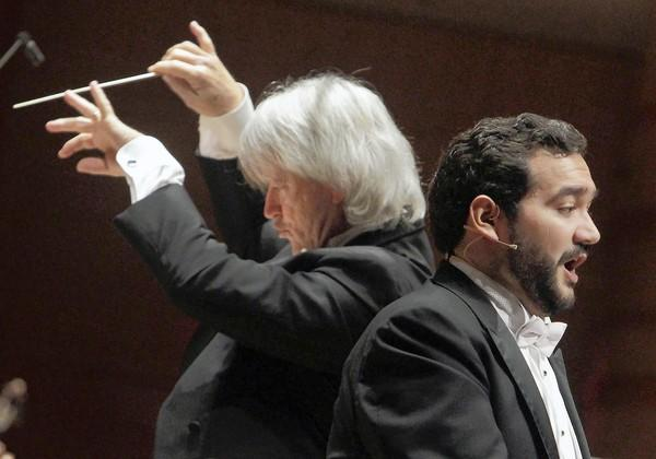 "Tenor Rene Barbera, right, performs William Bolcom's ""Canciones de Lorca"" with the Pacific Symphony conducted by Carl St.Clair."