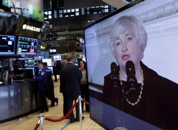 Traders work on the floor of the New York Stock Exchange on Oct. 9 as news is broadcast of Janet Yellen's nomination by President Obama to chair the Federal Reserve.