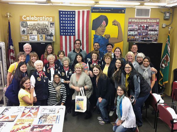Nearly 30 teachers from Glendale and Burbank pose with docents at the Rosie the Riveter Museum in Richmond, Calif. while on a field study in the Bay Area earlier this month that was paid for by the federal Teaching American History grant. The grant program has awarded Glendale Unified $4 million since 2001, enabling more than 100 teachers to travel the U.S. for field studies and history conferences.
