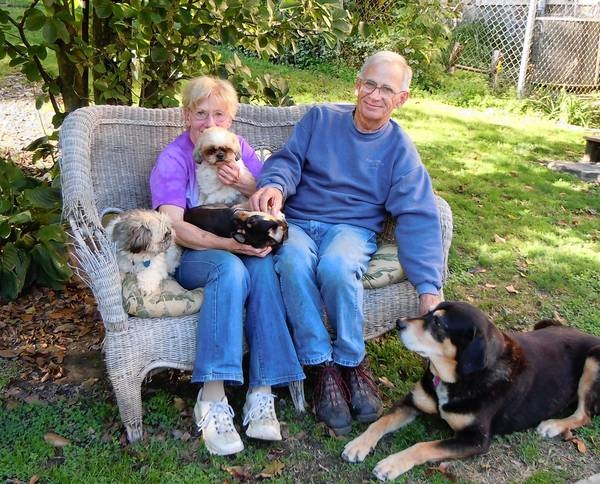 Carla and Barry Haynes with foster dogs Bear and Pudgy (Shih Tzus), Buddy (Chihuahua) and Sampson (coonhound mix).