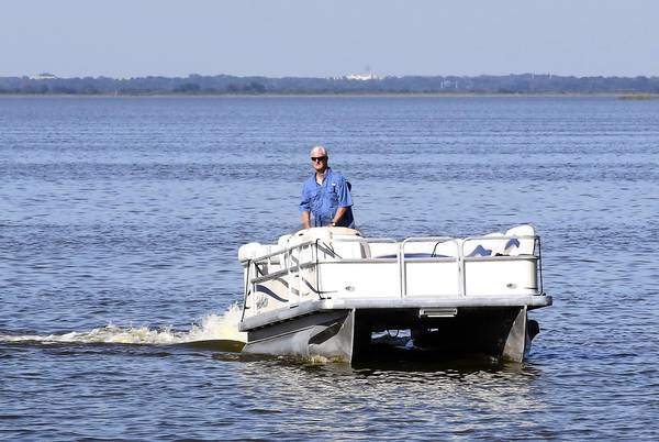 "Ronald Sikes remembers what he thought three years ago when a friend suggested a boating trip on Lake Apopka. ""That polluted mess? I wouldn't dip my toe in it,"" said Sikes, a Central Florida native who will serve as the captain on Lake Apopka boat tours. He is among those who think the best way to save the giant lake is to open it up to more people. A push is mounting to fund a new public boat ramp in Oakland."