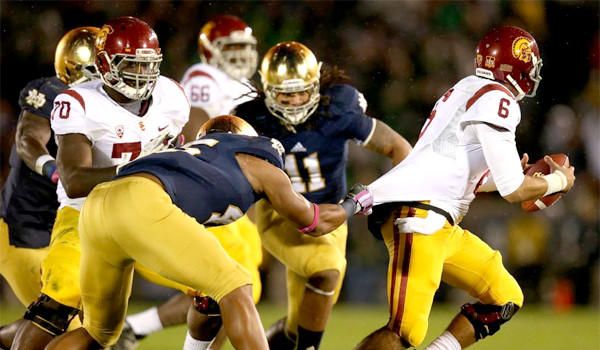 USC quarterback Cody Kessler tries to escape from Notre Dame linebacker Romeo Okwara during the Trojans' 14-10 loss to the Fighting Irish on Saturday.