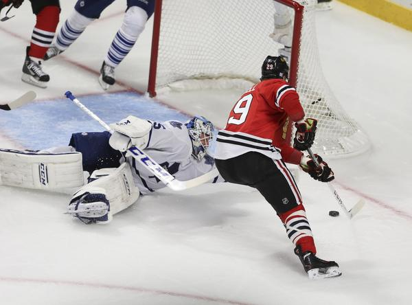 Bryan Bickell scores a goal against Maple Leafs goalie Jonathan Bernier during the second period.
