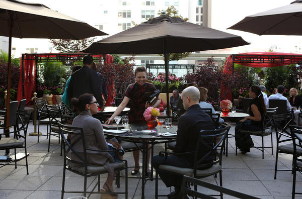 Patrons enjoy themselves in the outdoor terrace of the Peninsula Hotel on June 14, 2012.