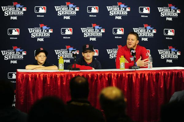 Red Sox starting pitcher Jake Peavy talks with the media during workouts a day before Game 3.