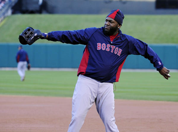 David Ortiz throws during workouts a day before Game 3 at Busch Stadium.