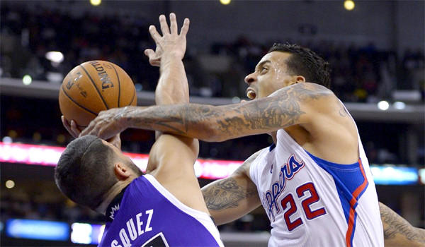 Forward Matt Barnes puts up a shot against Sacramento's Greivis Vasquez during his first preseason game for the Clippers. Barnes had been out with a sore left calf.