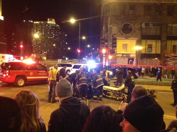Firefighters work to free a woman whose foot became trapped in a gap in a Michigan Avenue crosswalk.