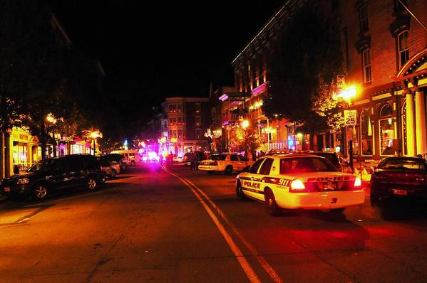 Police cars fill Broadway in Jim Thorpe on Friday night after police say a Lansford police officer shot himself to death. The 33-year-old officer also was a Carbon County deputy sheriff.