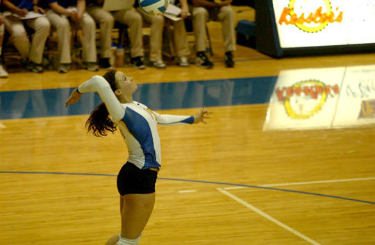 Kendall McDaniel serves for Central against Brandon Valley Friday night in Aberdeen.