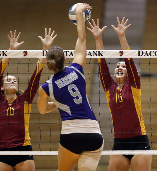 Northern State University's Tori Biach, left and Macey Finizio, right, defend the net as Winona State University's Kylea Roeglin, center, hits the ball during Friday night's match at Wachs Arena. photo by john davis taken 10/25/2013