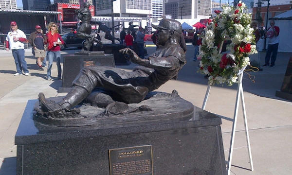 A wreath stands next to a statue honoring Cardinals great Enos Slaughter outside Busch Stadium in St. Louis on Saturday.