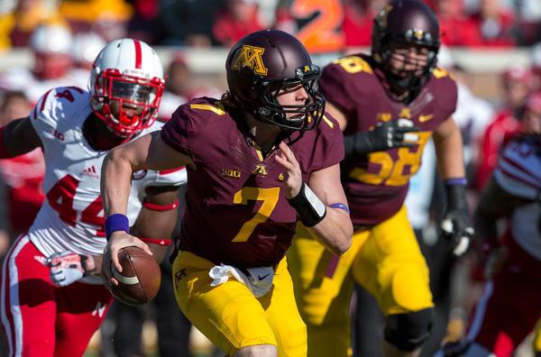 Minnesota quarterback Mitch Leidner scrambles in the first quarter Saturday.