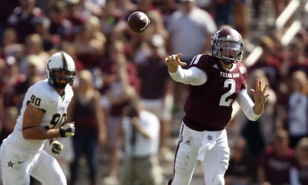 Texas A&M quarterback Johnny Manziel makes a pass during Saturday's 56-24 victory over Vanderbilt.