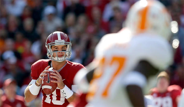 Alabama quarterback A.J. McCarron completed 19 of 27 passes for 275 yards and two touchdowns in the Crimson Tide's 45-10 win over the Tennessee Volunteers on Saturday.