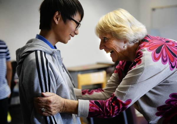 "Chinese exchange student Jixian ""Johnny"" Wang, 15, gets a pep talk from Rinate Jefferson, an official with the private recruiting company Tower Bridge, during a class break at Murrieta Valley High School. Johnny is part of a trend that's seeing more Chinese youths coming to the U.S. for high school before trying to get into American universities."
