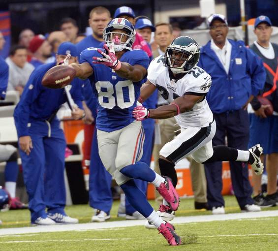Oct 6, 2013; East Rutherford, NJ, USA; New York Giants wide receiver Victor Cruz (80) cannot catch a pass while defended by Philadelphia Eagles cornerback Brandon Boykin (22) during the game at MetLife Stadium.