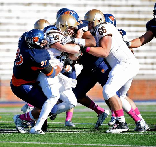 Lehigh's Brandon Bialkowski (10) is brought down by Bucknell defensive lineman Demetrius Baldwin-Youngblood (97) and linebacker Matt Johnson (44) during their game in Lewisburg on Saturday, October 26, 2013.