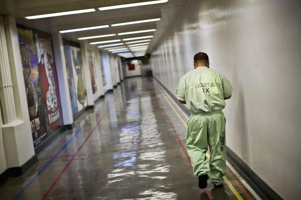 An inmate walks inside L.A. County's Men's Central Jail. Jailers suspect some inmates claimed to be homeless so they could stay in jail and take advantage of an early release without any supervision rather than spend their full sentences on home detention with electronic monitoring, officials said.