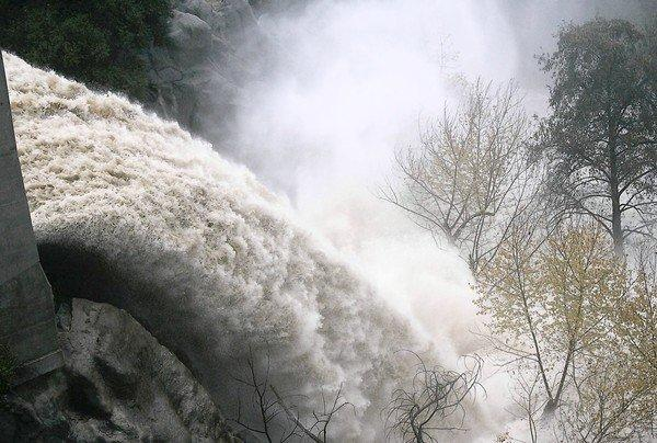 Runoff from the Devil's Gate reservoir in Pasadena in 2005. Officials say sediment and debris behind the dam have compromised its capacity to prevent flooding downstream in major storms.
