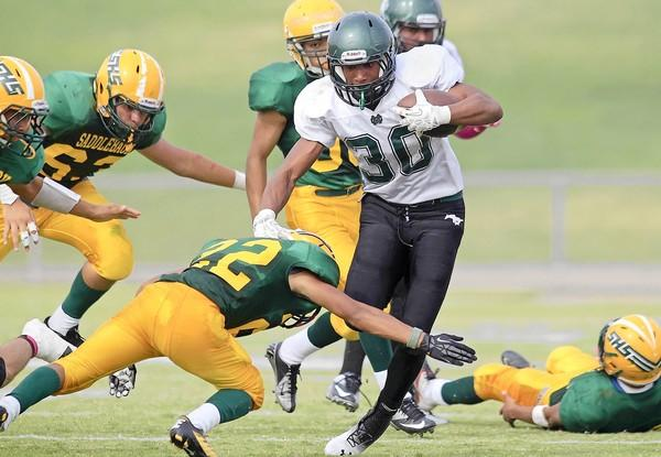 Costa Mesa High's Oronde Crenshaw (30) ran for 266 yards and three touchdowns on 21 carries against Saddleback in an Orange Coast League game at Segerstrom High in Santa Ana on Saturday.