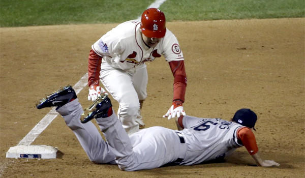 St. Louis' Allen Craig gets tangled with Boston's Will Middlebrooks during the ninth inning of Game 3 of the World Series. Middlebrooks was called for obstruction on the play and Craig went in to score the game-winning run.