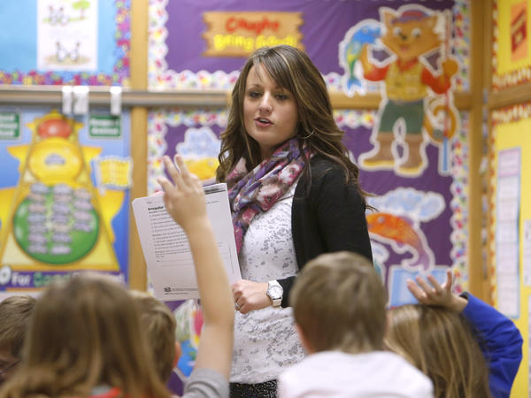 Mandy Brown works with her third-grade students at Simmons Elementary School on a language arts assignment. Brown and her sister are taking a proactive stance in their health.