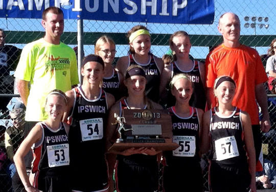 The Ipswich girls won the State B cross country title Saturday in Rapid City: (back from left) volunteer coach Jesse Kroupa, Taylor Maurer, Tory Makela, Ashlee Thorson and coach Todd Thorson; (front) Bailey Hammrich, Macy Heinz, Tori Moore, Taylor Loken and Aleah Steger.