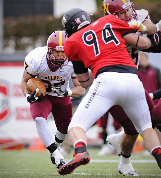 Northern State's Sean Schweichler heads for a hole in the line against St. Cloud State in the first quarter at Husky Stadium Saturday, Oct 26.