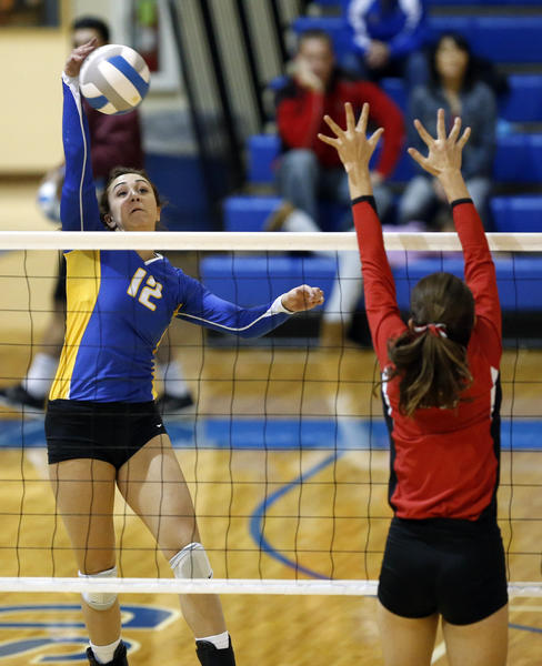 Aberdeen Central's Bridget White, left, tries to hit the ball past Yankton's Becky Frick, right, during Saturday's match at the Golden Eagles Arena. photo by john davis taken 10/26/2013