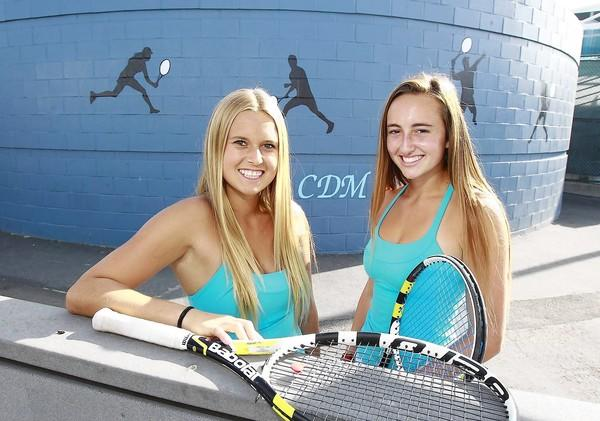 The Corona del Mar High girls' tennis doubles team of Siena Sharf, left, and Jasie Dunk, have been key players.