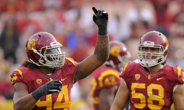 USC defensive end Leonard Williams, left, celebrates with teammate J.R. Tavai after a sack during the Trojans' 19-3 win over Utah.