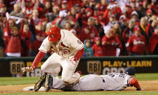 St. Louis baserunner Allen Craig, left, trips over Boston third baseman Will Middlebrooks before scoring the winning run on an obstruction call during the ninth inning of the Cardinals' 5-4 win in Game 3 of the World Series on Saturday.