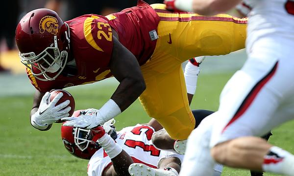 USC running back Tre Madden bowls over Utah defensive back Eric Rowe during the second quarter of Saturday's 19-3 win over Utah.