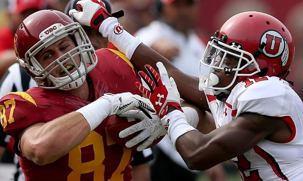 USC tight end Chris Willson, left, tries to power his way past Utah defensive back Justin Thomas during the first half of the Trojans' 19-3 win Saturday.