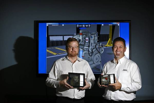 DiSTI Corporation co-founder and Chief Technology Officer, SR. VP Darren Humphrey, left, and Scott Ariotti, Director of Global Marketing, right, show the virtual engine app on two iPads at their office in Orlando on October 24, 2013.
