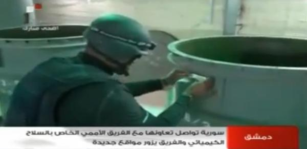 An image grab taken from Syrian television on Oct. 19 shows an inspector from the Organization for the Prohibition of Chemical Weapons (OPCW) at work at an undisclosed location in Syria.