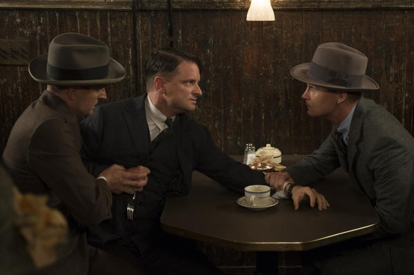 "Gangster Eli Thompson (Shea Whigham), center, is confronted by federal agents (Jacob Ware and Brian Geraghty) on ""Boardwalk Empire."""