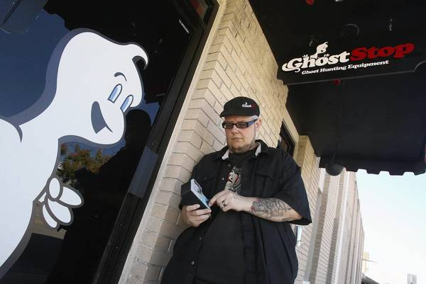 Shawn Porter holds an electromagnetic-fields detector outside his St. Cloud ghost-hunting store, Ghost Stop. He has a large selection of gadgets, some of which he invented himself, to document the presence of the paranormal.
