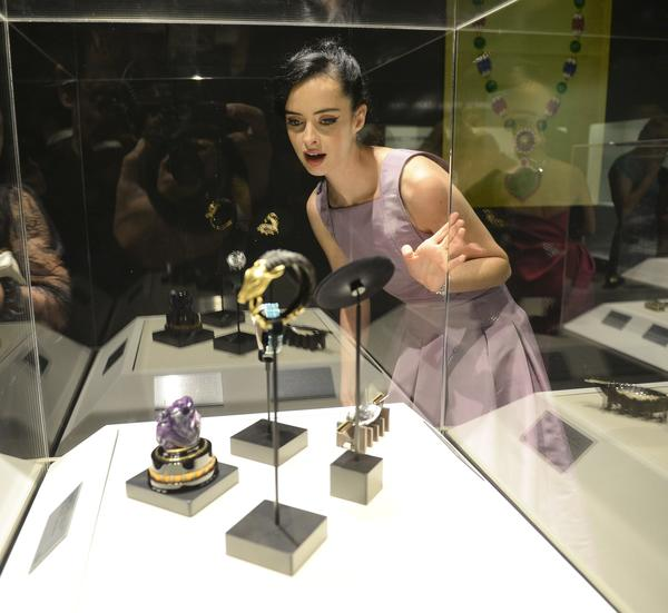 "Krysten Ritter views some of the pieces on display at ""A Quest for Beauty: The Art Of Van Cleef & Arpels"" at the Bowers Museum in Santa Ana"