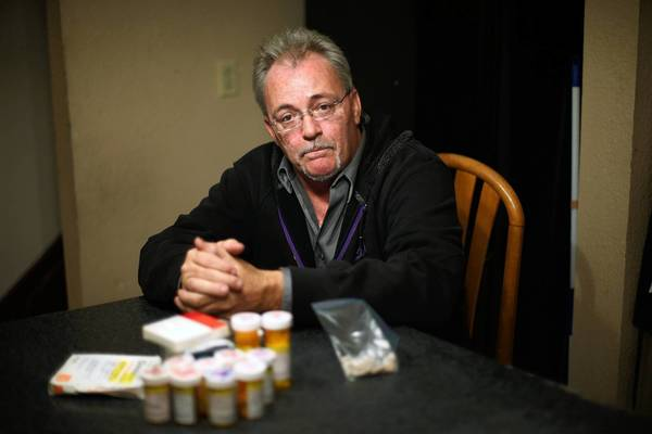 Michael Graham with some of the medications he used to take to treat his degenerative disc disease. Graham began using medical marijuana about five years ago, which allowed him to stop using most of the pharmaceuticals for pain relief.